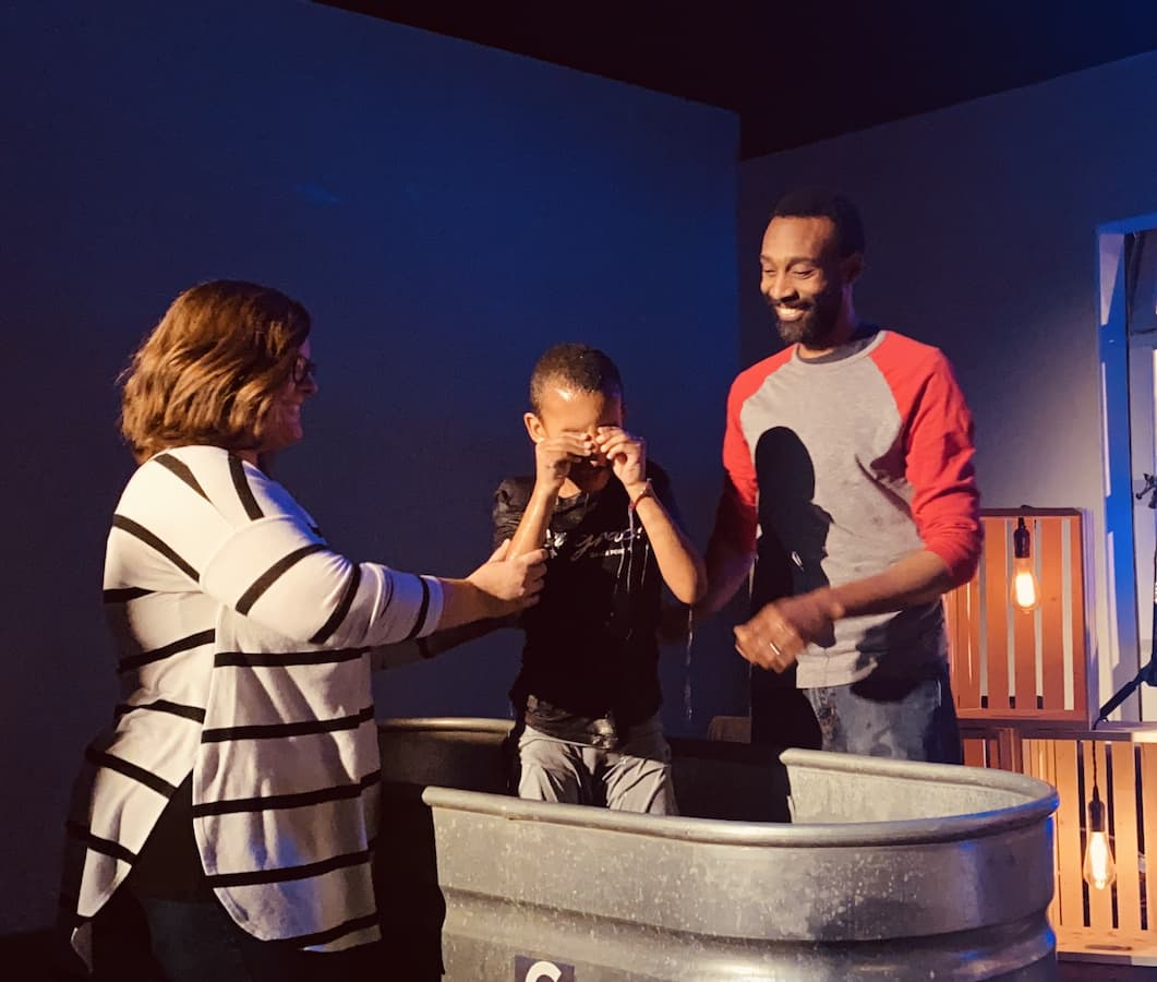 being raised from water after being baptised
