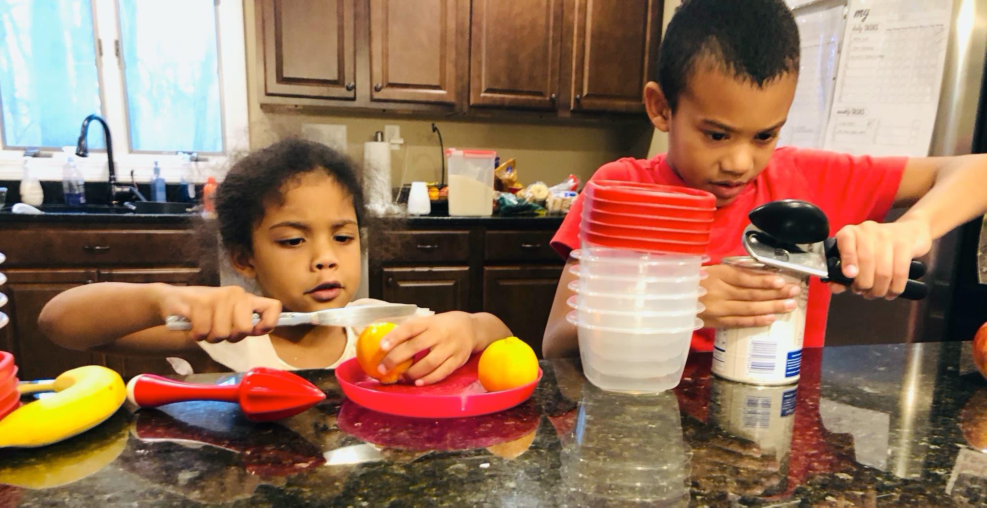Kids making fruit salad